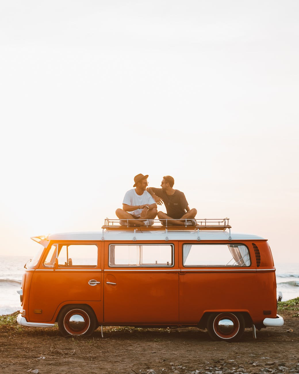 life rules showing happy friends on camper van roof