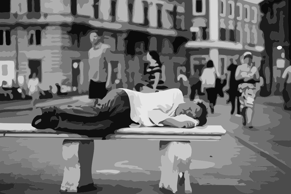 a man sleeping on a bench on the street. Depicting how hard it is to control what happens in life.