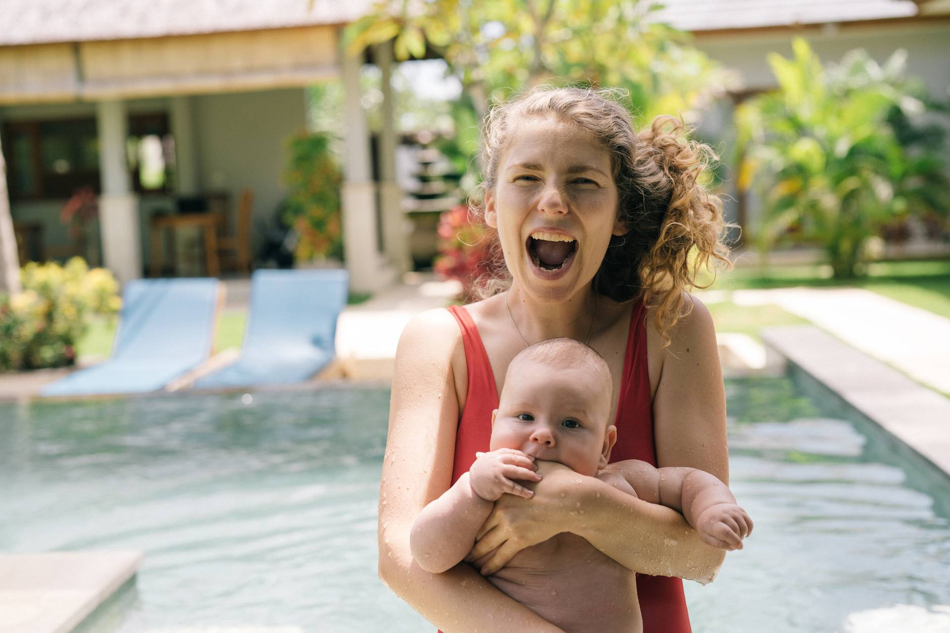 photo of woman holding baby