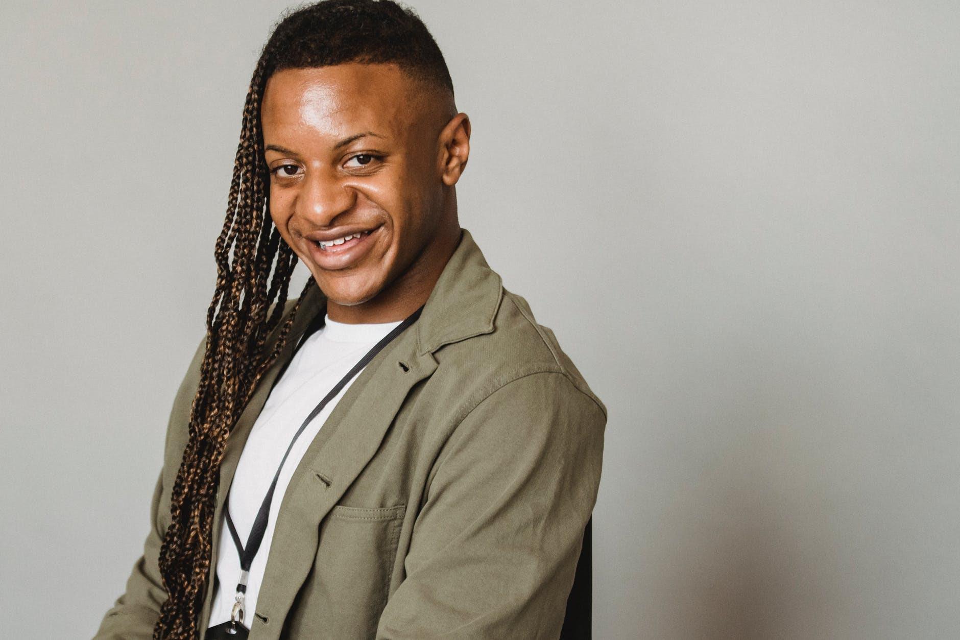 happy feminine black man in studio